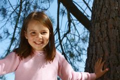 Girl climbing tree Royalty Free Stock Image