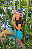 Girl climbing a tree Royalty Free Stock Photography