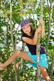 Girl climbing a tree Stock Photography