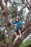 Girl climbing tree Royalty Free Stock Photography