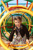 Girl climbing through a tunnel Royalty Free Stock Photo