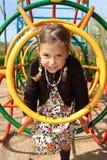 Girl climbing through a tunnel Royalty Free Stock Photos
