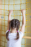 Girl climbing up the gymnastic stairs Royalty Free Stock Photos