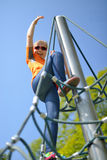 Girl climbing up the ropes. Stock Image