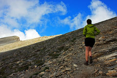 Girl climbing up to Skala peak on Mount Olympus Royalty Free Stock Photography