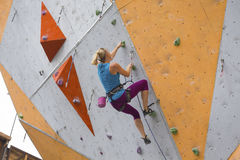 Girl climbing up the wall. Bouldering, girl climbing up the wall Stock Photography