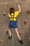 Girl climbing wall Royalty Free Stock Photos