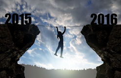 Girl climbs through the abyss into the New Year 2016. Stock Image