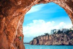 A girl climbs a climbing route stock photo