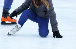 Girl climbs after falling on skates Stock Images