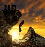 Girl climbs into the New Year 2015. Stock Photography