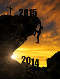 Girl climbs into the New Year 2015 Royalty Free Stock Photo