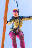 Girl climbs into ropes course. Fearfully Stock Image