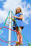 The girl climbs the ropes Stock Photo