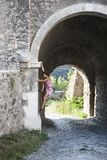 The girl climbs the stone wall. royalty free stock photos