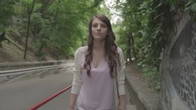Girl climbs up on the street stock video footage