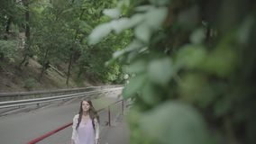 Girl climbs up on the street stock footage