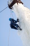 Girl climbs upward on ice climbing competition Royalty Free Stock Photos