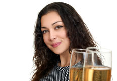 Girl clinking glasses with wine and toasting, beauty portrait, black and white checkered dress, long curly hair, glamour concept, Royalty Free Stock Image