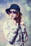 Girl in cloak. Redhead girl in cloak as a spy. Studio shot stock photography