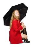 Girl in cloak with umbrella Stock Photography