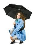 Girl in cloak with umbrella. Royalty Free Stock Image