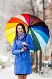 Girl in cloak with umbrella Stock Photos