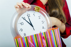 The girl with the clock Stock Image