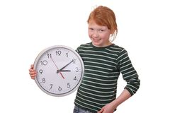 Girl with a clock Stock Photos