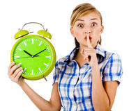 Girl with the clock asking us to maintain silence Royalty Free Stock Photography