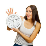 The girl with clock in hands is happy Stock Photo