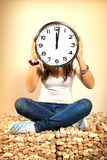 Girl with clock on head Royalty Free Stock Photo