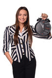 Girl with clock. Girl in jacket with black clock Royalty Free Stock Photography