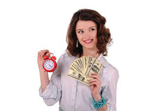 Girl with clock and money. Girl with an alarm clock and money royalty free stock photography