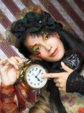 Girl with clock. Royalty Free Stock Photography
