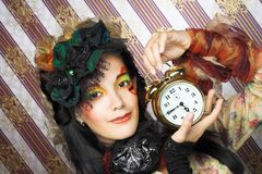 Girl with clock. Stock Photo