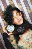 Girl with clock. Stock Images