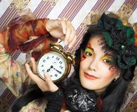 Girl with clock. Stock Photography
