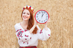 Girl with clock Royalty Free Stock Photography
