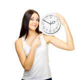 The girl with clock on a shoulder Stock Photos