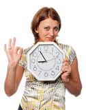 Girl with the clock shows gesture Royalty Free Stock Image