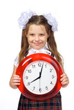 A girl and a clock Royalty Free Stock Images