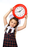 A girl and a clock Stock Photos