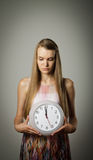 Girl and clock. Royalty Free Stock Photo