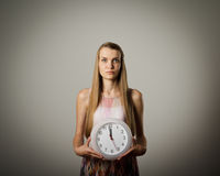 Girl and clock. Stock Images