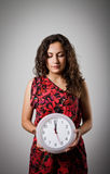 Girl and clock. Royalty Free Stock Photography