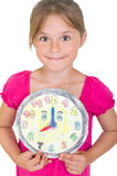 Girl with clock. Young girl with a homemade clock Stock Image