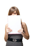 Girl close the face of a blank sheet of paper Stock Photo