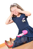 Girl close her eyes while playing with kids make-up Stock Photo