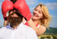 Girl close his eyes boxing gloves. Cunning strategy win. Savvy key to success. Blind boxer can not attack opponent. Girl. Use cunning trick in fight. Couple in stock image